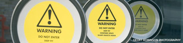 warning label on underground bin