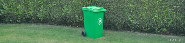 green wheelie bin against green backdrop